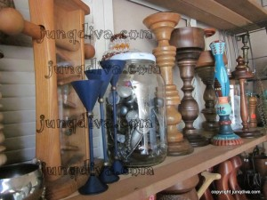 A gallon jar of vintage knobs and handles along with a variety of wood items awaiting Re-Creation.